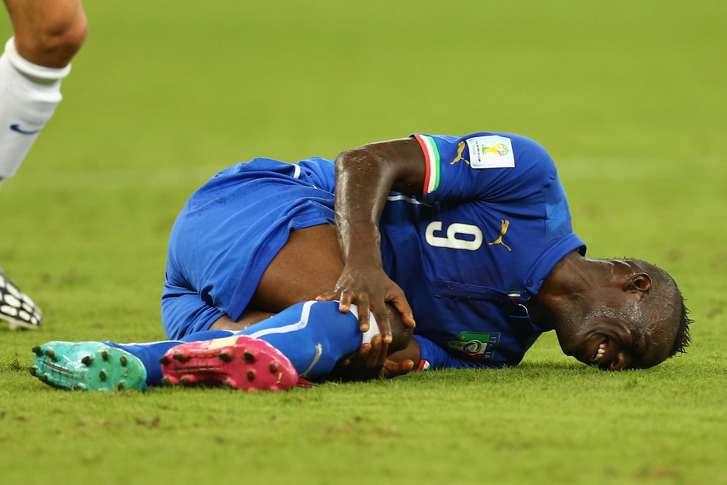 . Mario Balotelli of Italy lies on the field after a tackle during the 2014 FIFA World Cup Brazil Group D match between England and Italy at Arena Amazonia on June 14, 2014 in Manaus, Brazil.  (Photo by Elsa/Getty Images)
