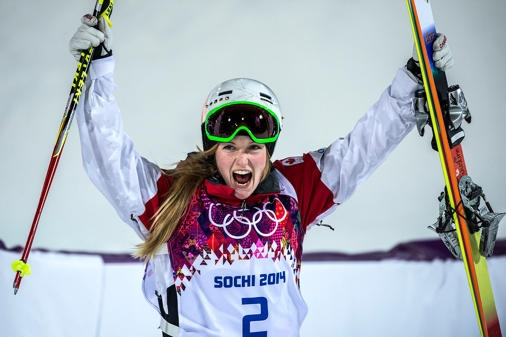 . KRASNAYA POLYANA, RUSSIA  - JANUARY 8: Justine Dufour-Lapointe, of Canada, celebrates after winning the Ladies\' Moguls Finals at Rosa Khutor Extreme Park during the 2014 Sochi Olympic Games Saturday February 8, 2014. Justine Dufour-Lapointe won gold with a score of 22.44. Her sister Chloe Dufour-Lapointe won the silver with a score of 21.66. Hannah Kearney, of USA, won bronze with a score of 21.49. (Photo by Chris Detrick/The Salt Lake Tribune)