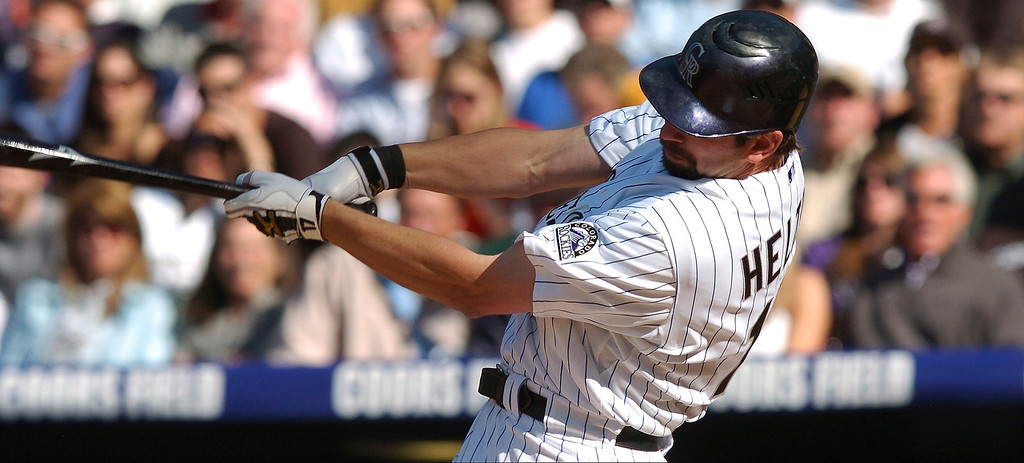 . Todd Helton takes a swing as the Colorado Rockies took on the Arizona Diamondbacks in their home opener at Coors Field in 2008.  The Denver Post / Hyoung Chang