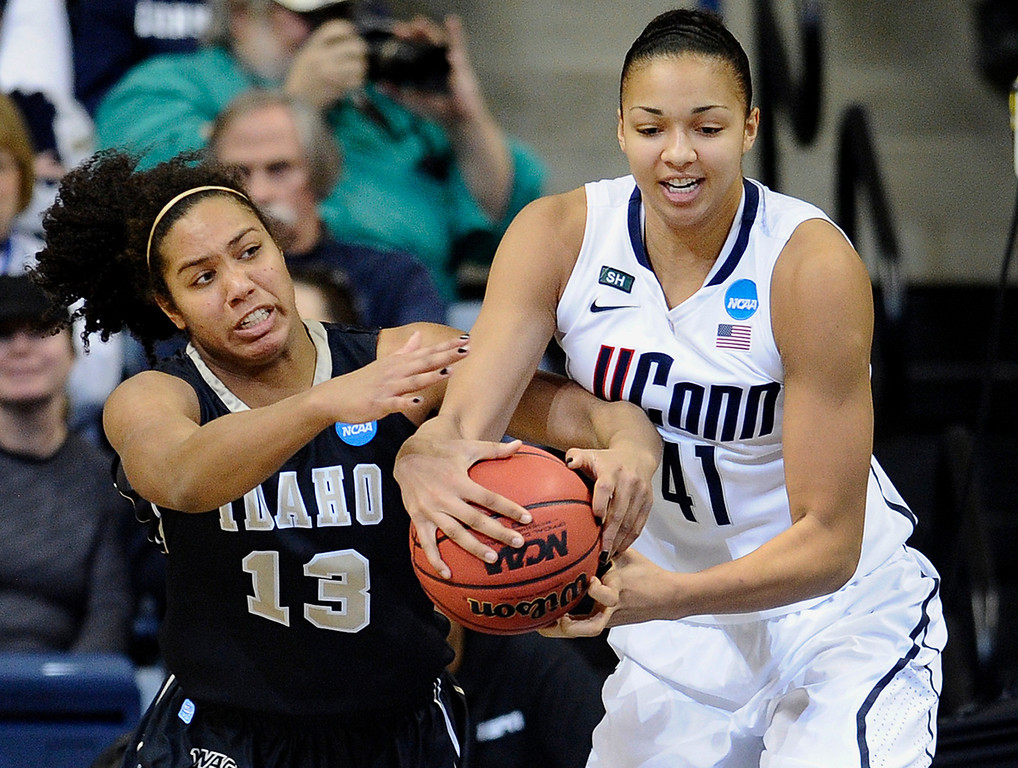 . Idaho\'s Ali Forde, left, and Connecticut\'s Kiah Stokes fight for a rebound in the first half of a first-round game in the women\'s NCAA college basketball tournament in Storrs, Conn., Saturday, March 23, 2013. (AP Photo/Jessica Hill)