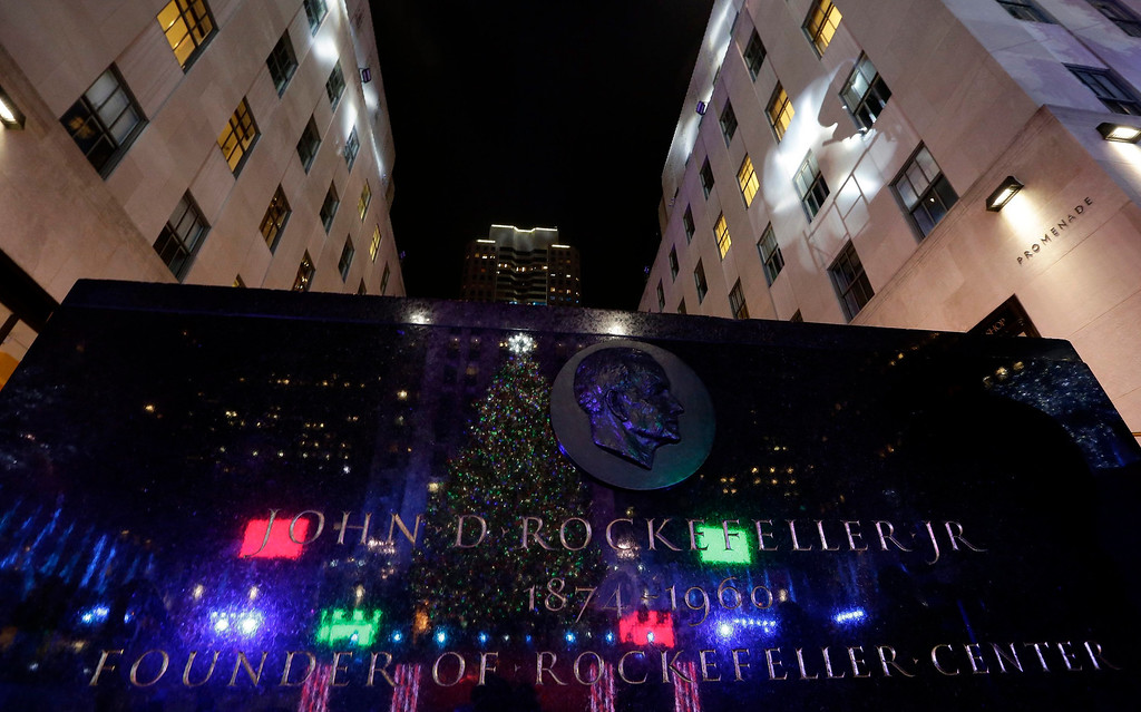 . The Rockefeller Center Christmas tree is seen reflected in a marble bust of John D. Rockefeller during the 81st annual lighting ceremony in New York, New York, USA, 04 December 2013. 45,000 energy efficient LED lights we\'re installed on the 76-foot--tall tree,  plus other decorations. The Rockefeller Center Christmas tree is a New York institution and was started in 1933.  EPA/JASON SZENES