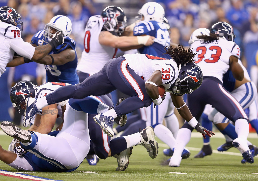 . Deji Karim #39 of the Indianapolis Colts runs with the ball during the NFL game against the Houston Texans at Lucas Oil Stadium on December 15, 2013 in Indianapolis, Indiana.  (Photo by Andy Lyons/Getty Images)