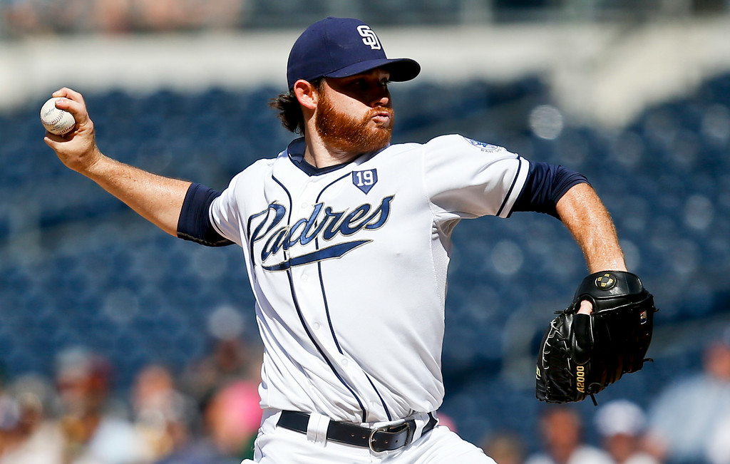 . San Diego Padres starting pitcher Ian Kennedy works against the Colorado Rockies in the first inning of a baseball game Wednesday, Aug. 13, 2014, in San Diego. (AP Photo/Lenny Ignelzi)