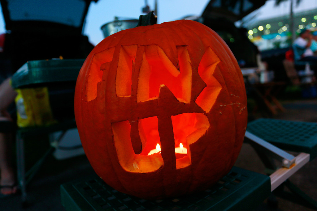 . MIAMI GARDENS, FL - OCTOBER 31: A carved pumpkin in the car park encourages the Miami Dolphins prior to their game against the Cincinnati Bengals at Sun Life Stadium on October 31, 2013 in Miami Gardens, Florida. (Photo by Chris Trotman/Getty Images)