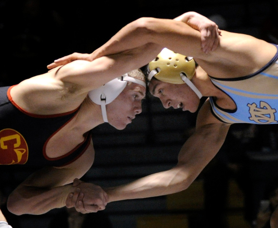 . ARVADA, CO - JANUARY 19: Coronado High School wrestler Trent Watson, left, went head-to-head with opponent Anthony Garza, right, from Greeley West in the championship of the 106-pound weight class. Watson prevailed 5-4. The Arvada West High School wrestling tournament wrapped up Saturday night, January 19, 2013. Karl Gehring/The Denver Post