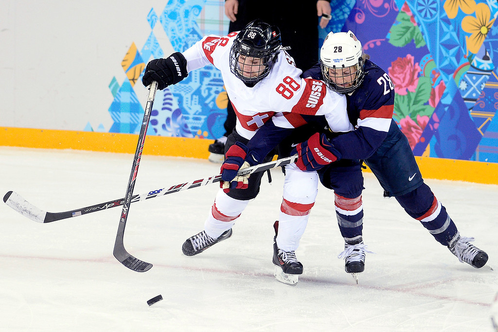 . Amanda Kessel (28) of the U.S.A. defends Phoebe Stanz (88) of the Switzerland during the third period of the United States\' 9-0 win at the Shayba Arena. Sochi 2014 Winter Olympics on Monday, February 10, 2014. (Photo by AAron Ontiveroz/The Denver Post)