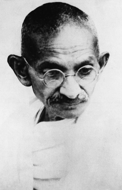 . Mahatma Gandhi is shown before his arrest in Surat, Bombay, for disobeying the salt laws, May 13, 1930. (AP Photo)