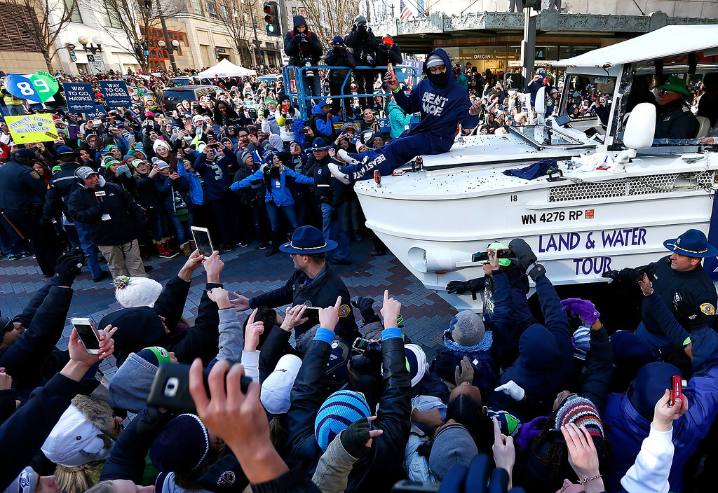 . Marshawn Lynch #24 of Seattle Seahawks throws out Skittles to fans during a parade to celebrate their  victory in Super Bowl XLVII on February 5, 2014 in Seattle, Washington.  (Photo by Jonathan Ferrey/Getty Images)