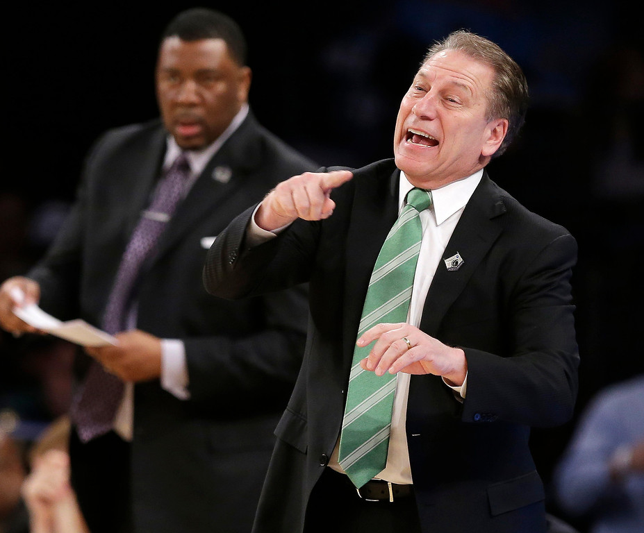 . Michigan State head coach Tom Izzo instructs his team in the first half of a regional final against Connecticut at the NCAA college basketball tournament on Sunday, March 30, 2014, in New York. (AP Photo/Frank Franklin II)