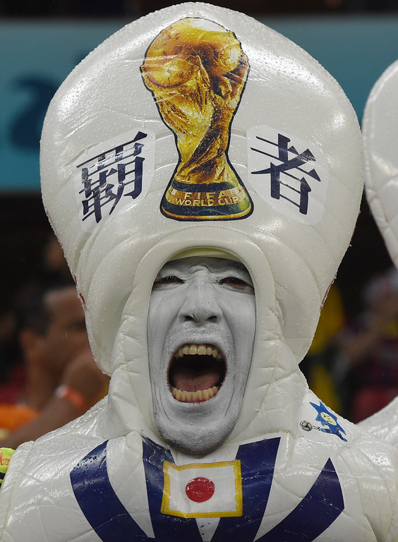 . A Japanese fan dressed up as a pinball cheers as he awaits the kick-off of a Group C football match between Ivory Coast and Japan at the Pernambuco Arena in Recife during the 2014 FIFA World Cup on June 14, 2014.   JAVIER SORIANO/AFP/Getty Images
