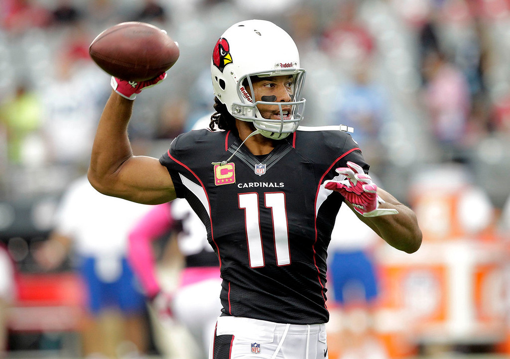 . Arizona Cardinals wide receiver Larry Fitzgerald (11) warms up prior to a NFL football game against the Carolina Panthers, Sunday, Oct. 6, 2013, in Glendale, Ariz. (AP Photo/Rick Scuteri)