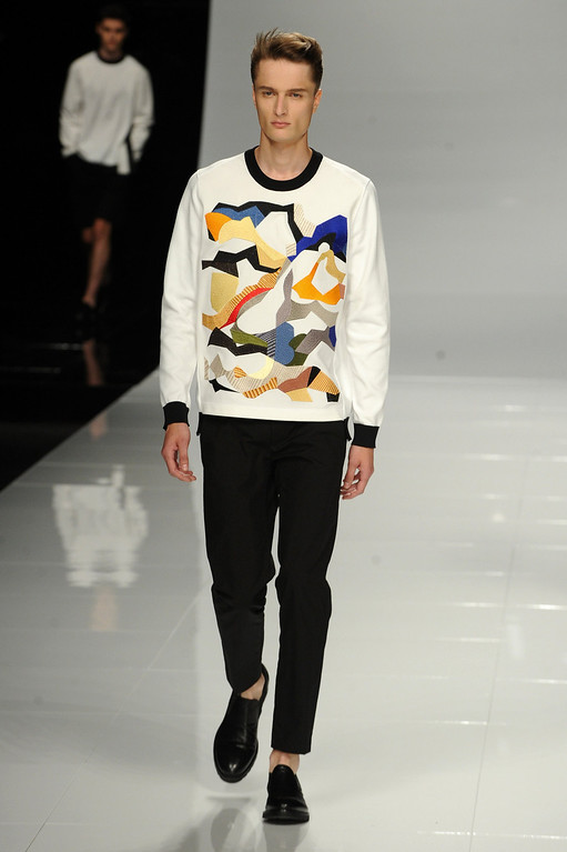 . A model walks the runway at the Iceberg show during Milan Menswear Fashion Week Spring Summer 2014 on June 23, 2013 in Milan, Italy.  (Photo by Pier Marco Tacca/Getty Images)