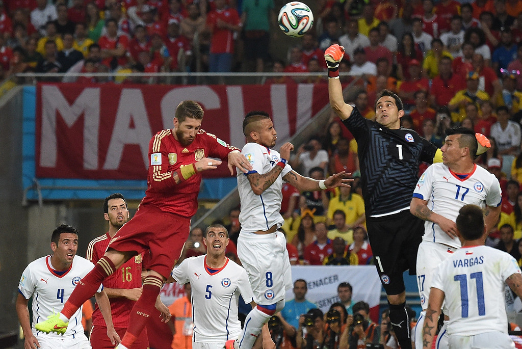 . Chile\'s goalkeeper and captain Claudio Bravo punches the ball out during a Group B football match between Spain and Chile in the Maracana Stadium in Rio de Janeiro during the 2014 FIFA World Cup on June 18, 2014.  CHRISTOPHE SIMON/AFP/Getty Images