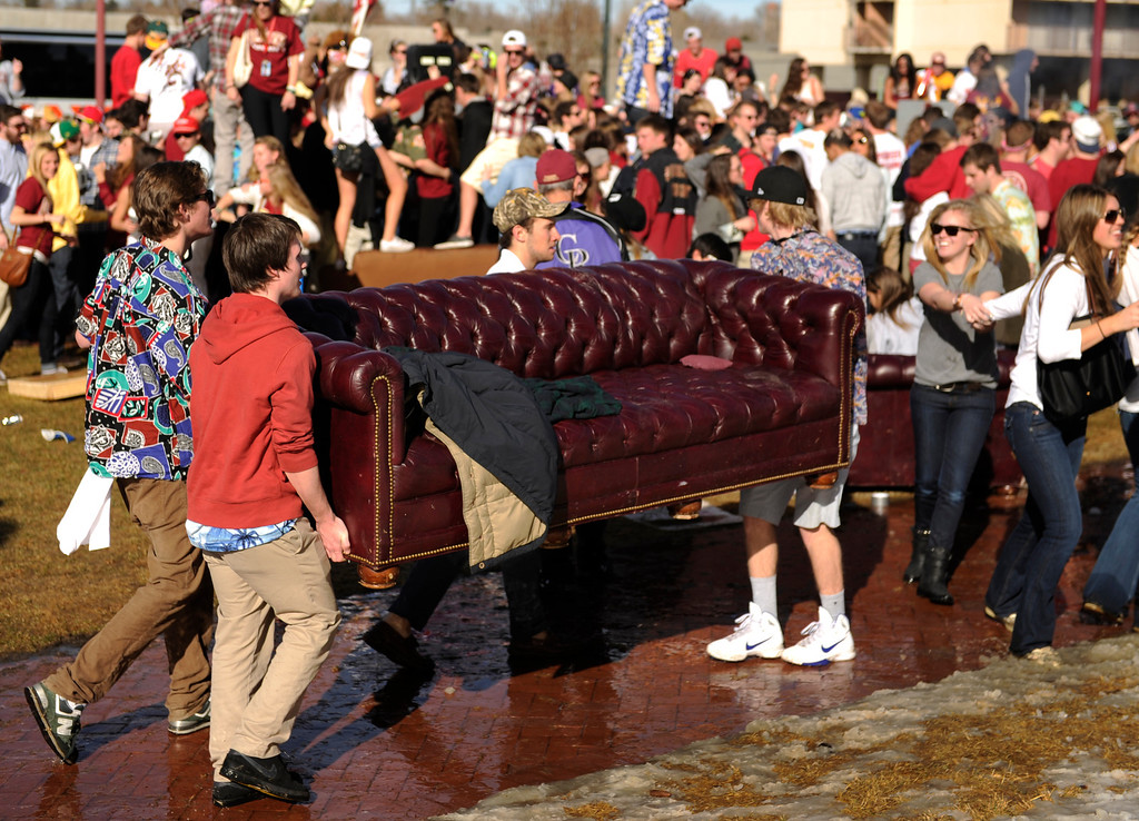 . DENVER, CO. - MARCH 2: University of Denver students brought their coach to a party outside Magness Arena before the game. The University of Denver men\'s basketball team defeated New Mexico State 66-60 Saturday evening, March 2, 2013. (Photo By Karl Gehring/The Denver Post)