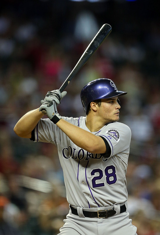 . Nolan Arenado #28 of the Colorado Rockies bats against the Arizona Diamondbacks during the MLB game at Chase Field on April 28, 2013 in Phoenix, Arizona.  (Photo by Christian Petersen/Getty Images)