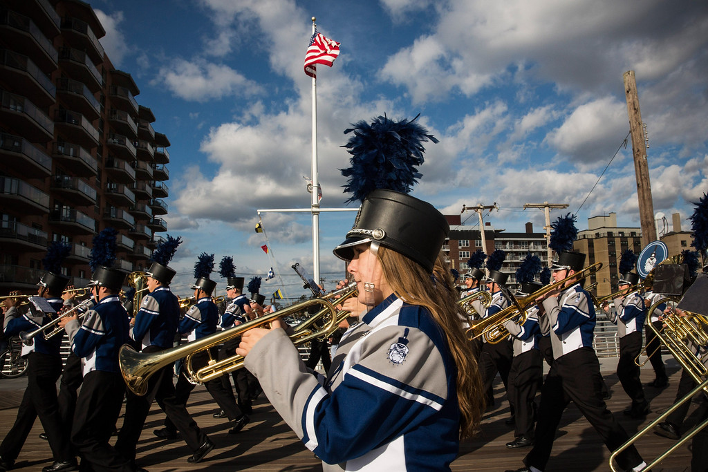 . LONG BEACH, NY - OCTOBER 25:  The Long Beach High School marching band plays while marching down the Long Beach boardwalk to officially reopen the boardwalk on October 25, 2013 in Long Beach, New York. The boardwalk was severely damaged by Superstorm Sandy last year, which killed 285 people and caused billions of dollars in damage. Long Beach\'s new boardwalk is made of Brazilian hardwood and is estimated to have a lifespan of 30-40 year; the previous boardwalk was only scheduled to last  three to seven years.  (Photo by Andrew Burton/Getty Images)