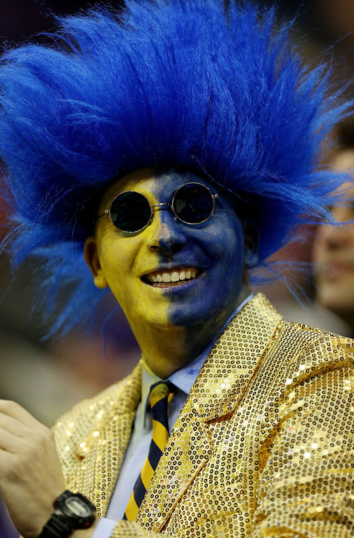 . KANSAS CITY, MO - MARCH 22: A fan of the La Salle Explorers cheers in the first half of the game against the Kansas State Wildcats during the second round of the 2013 NCAA Men\'s Basketball Tournament at the Sprint Center on March 22, 2013 in Kansas City, Missouri.  (Photo by Ed Zurga/Getty Images)