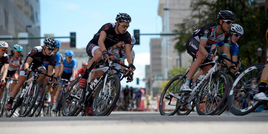 . Riders head in to a turn in Larimer Square during the final stage in the USA Pro Cycle Challenge as it makes it way through downtown Denver August 25, 2013. Aspen\'s Tejay van Garderen won the 3rd annual Pro Cycle Challenge. (Photo by John Leyba/The Denver Post)