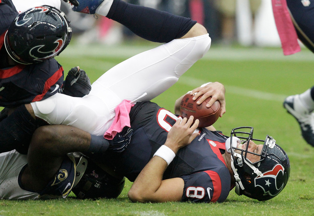 . Houston Texans quarterback Matt Schaub (8) is sacked by the St. Louis Rams during the first quarter of an NFL football game Sunday, Oct. 13, 2013, in Houston, Texas. (AP Photo/Patric Schneider)