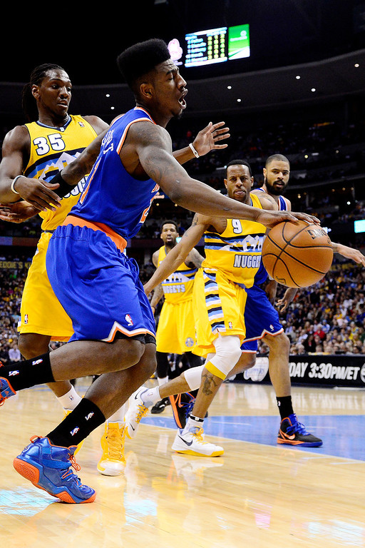 . DENVER, CO - MARCH 13: Iman Shumpert (21) of the New York Knicks drives against Kenneth Faried (35) of the Denver Nuggets during the first half of action. The Denver Nuggets play the New York Knicks at the Pepsi Center. (Photo by AAron Ontiveroz/The Denver Post)