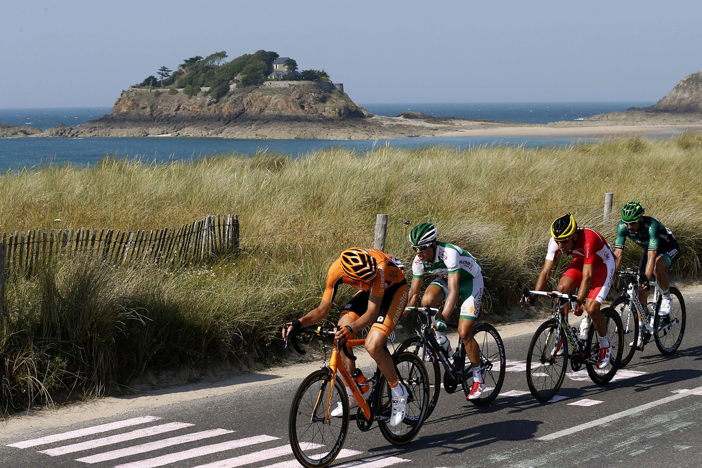 . Spain\'s Juan Jose Oroz, France\'s Julien Simon, Spain\'s Luis Mate Mardones, and France\'s Jerome Cousin rides along the sea during the 197 km tenth stage of the 100th edition of the Tour de France cycling race on July 9, 2013 between Saint-Gildas-des-Bois and Saint-Malo, northwestern France.    JOEL SAGET/AFP/Getty Images