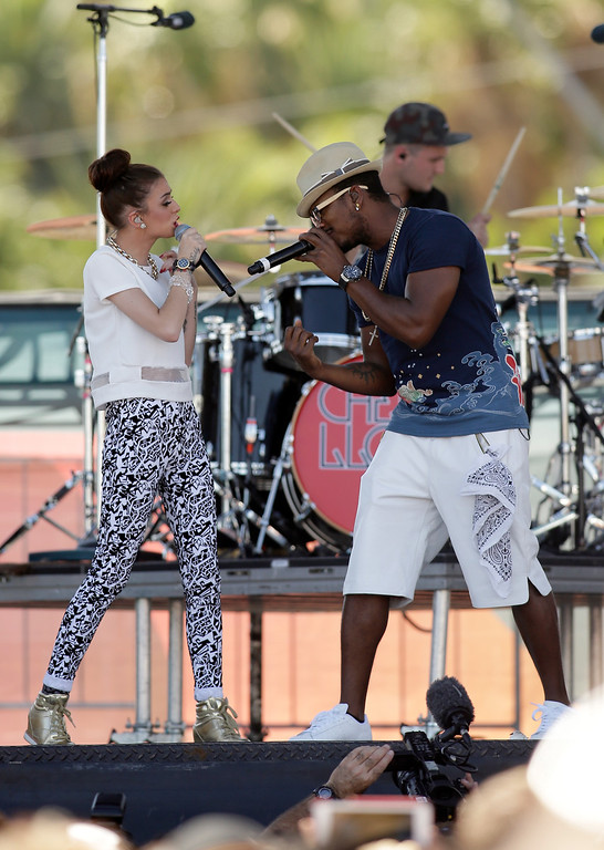 . Entertainers Cher Lloyd (L) and Ne-Yo perform onstage during the iHeart Radio Music Festival Village on September 21, 2013 in Las Vegas, Nevada.  (Photo by Isaac Brekken/Getty Images for Clear Channel)