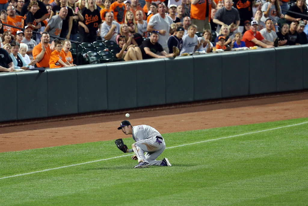 . BALTIMORE, MD - AUGUST 17:  Left fielder Corey Dickerson #6 of the Colorado Rockies misses catching a two RBI single by Nick Markakis #21 of the Baltimore Orioles (not pictured) during the third inning at Oriole Park at Camden Yards on August 17, 2013 in Baltimore, Maryland.  (Photo by Rob Carr/Getty Images)
