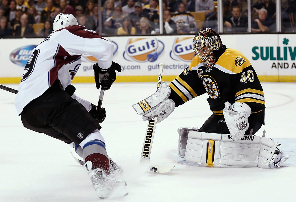 . Boston Bruins goalie Tuukka Rask makes a save as Colorado Avalanche\'s Matt Duchene looks for the rebound during the first period of an NHL hockey game in Boston on Thursday, Oct. 10, 2013. (AP Photo/Winslow Townson)