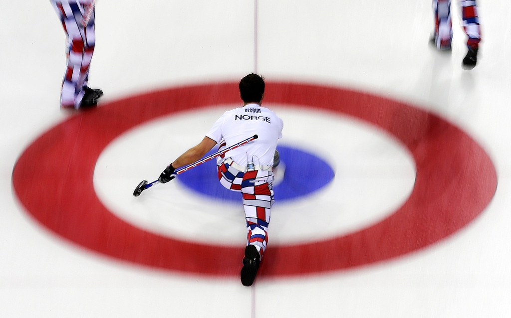 . Norway\'s skip Thomas Ulsrud delivers the rock during the men\'s curling competition against the United States at the 2014 Winter Olympics, Monday, Feb. 10, 2014, in Sochi, Russia. (AP Photo/Wong Maye-E)