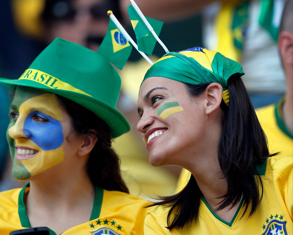 . Brazil fans attend the opening ceremony of the World Cup before the group A match between Brazil and Croatia, the opening game of the tournament, in the Itaquerao Stadium in Sao Paulo, Brazil, Thursday, June 12, 2014.  (AP Photo/Frank Augstein)