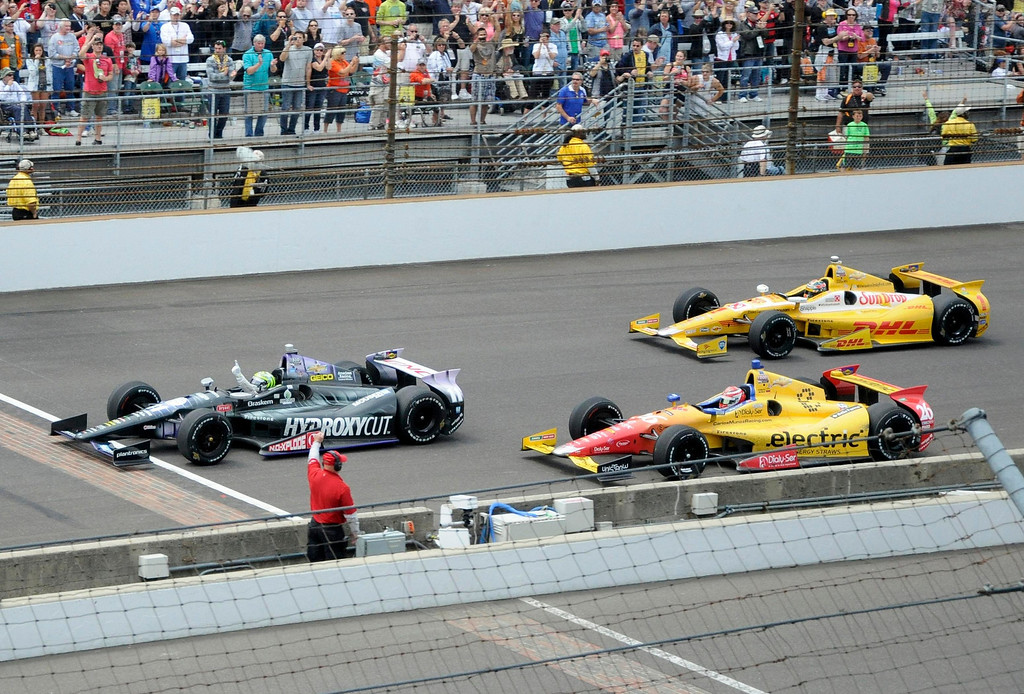 . KV Racing Technology driver Tony Kanaan of Brazil (L) wins ahead of Andretti Autosport driver Carlos Munoz of Colombia and Andretti Autosport Ryan Hunter-Reay of the U.S. (R) during the 97th running of the Indianapolis 500 at the Indianapolis Motor Speedway in Indianapolis, Indiana, May 26, 2013.  REUTERS/Geoff Miller