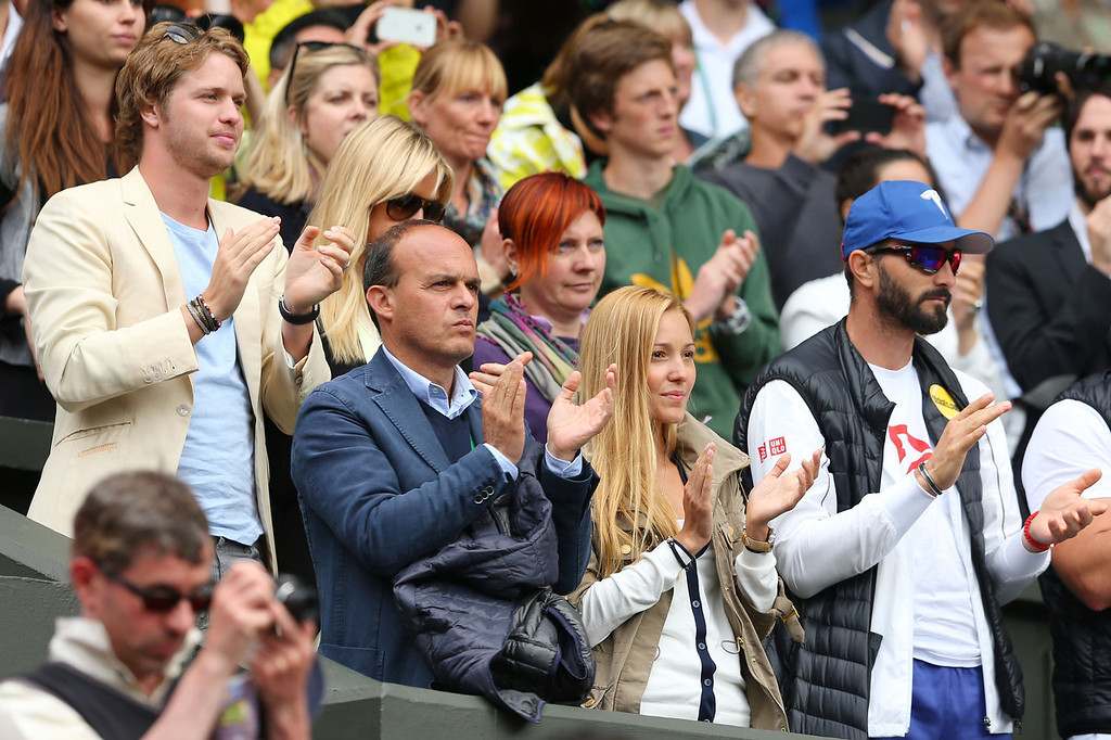 . Sam Branson (L) and Jelena Ristic (bottom centre), the girlfriend of Novak Djokovic of Serbia watch his Gentlemen\'s Singles first round match against Florian Mayer of Germany on day two of the Wimbledon Lawn Tennis Championships at the All England Lawn Tennis and Croquet Club on June 25, 2013 in London, England.  (Photo by Julian Finney/Getty Images)