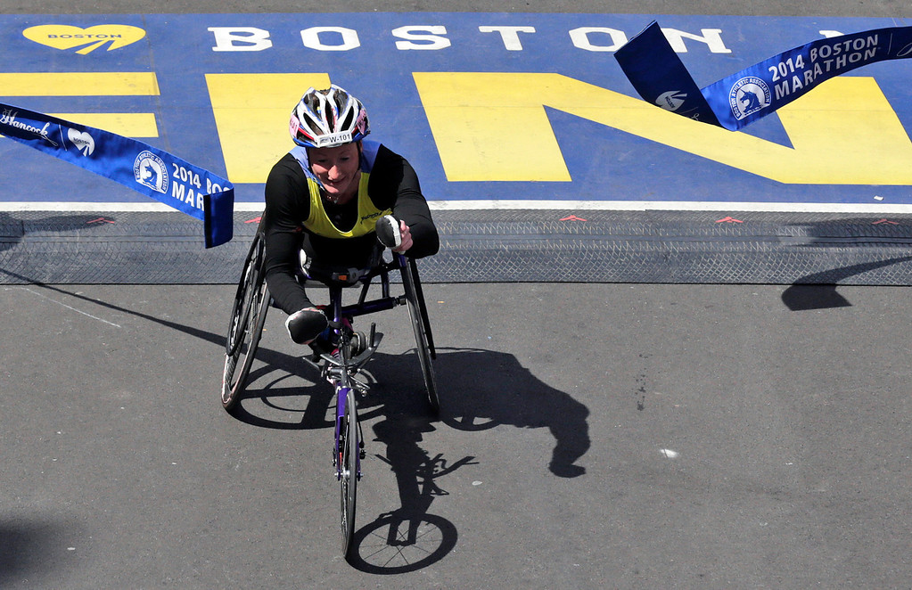 . Tatyana McFadden, of the United States, breaks the tape to win the women\'s wheelchair division of the 118th Boston Marathon Monday, April 21, 2014 in Boston. (AP Photo/Charles Krupa)