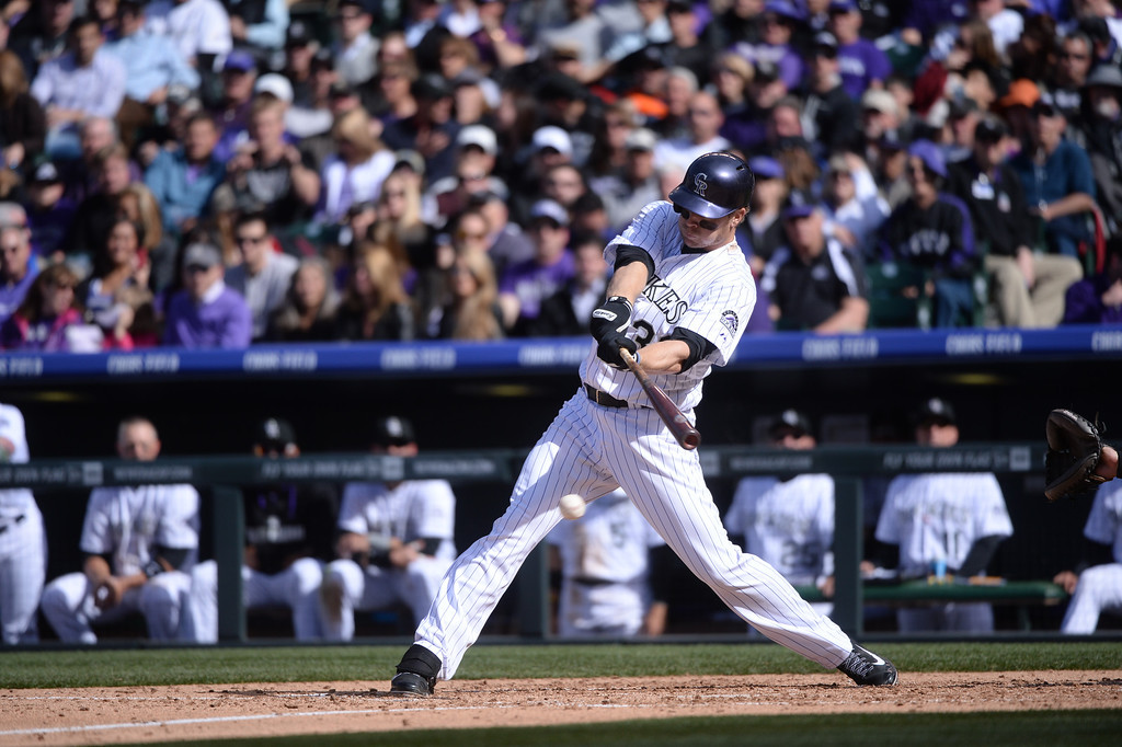 . DENVER, CO. - APRIL 4: Justin Morneau (33) hits a single up the middle during the fifth inning. The Colorado Rockies hosted the Arizona Diamondbacks in the Rockies season home opener at Coors Field in Denver, Colorado Friday, April 4, 2014. (Photo by Karl Gehring/The Denver Post)