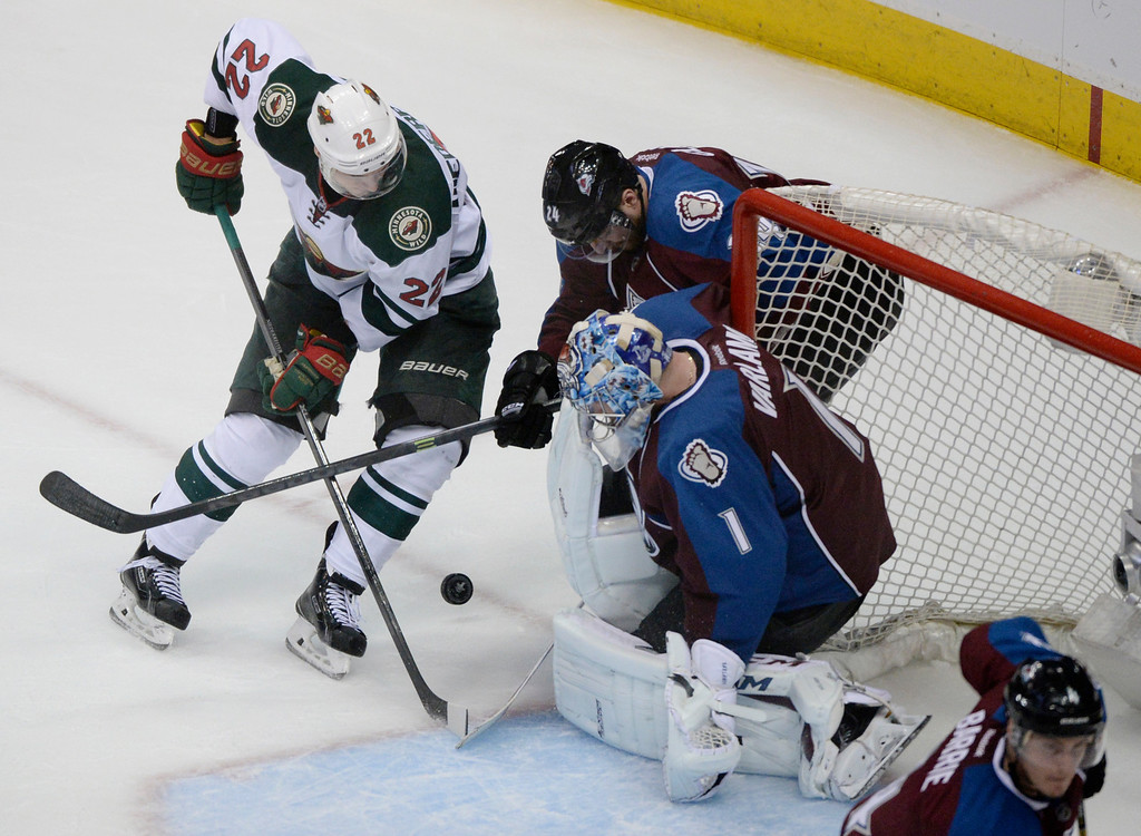 . Minnesota wing Nino Niederreiter (22) pressured Colorado goaltender Semyon Varlamov (1) in the third period. The Colorado Avalanche defeated the Minnesota Wild 4-2 at the Pepsi Center Saturday night, April 19, 2014 in an NHL playoff game. (Photo by Karl Gehring/The Denver Post)