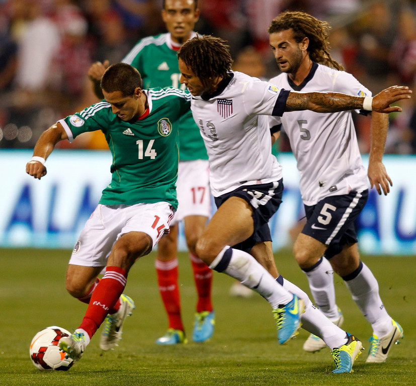 . Javier Hernandez (L) of Mexico works for the ball against Jermaine Jones (13) and Kyle Beckerman (5) during the first half of their Brazil 2014 FIFA World Cup qualifier at Columbus Crew Stadium in Columbus, Ohio, September 10, 2013.  AFP PHOTO / PAUL VERNONPaul VERNON/AFP/Getty Images