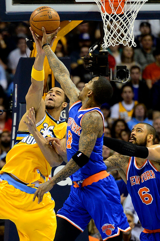 . DENVER, CO - MARCH 13: JaVale McGee (34) of the Denver Nuggets contends for a rebound against J.R. Smith (8) of the New York Knicks and Tyson Chandler during the first half of action. The Denver Nuggets play the New York Knicks at the Pepsi Center. (Photo by AAron Ontiveroz/The Denver Post)