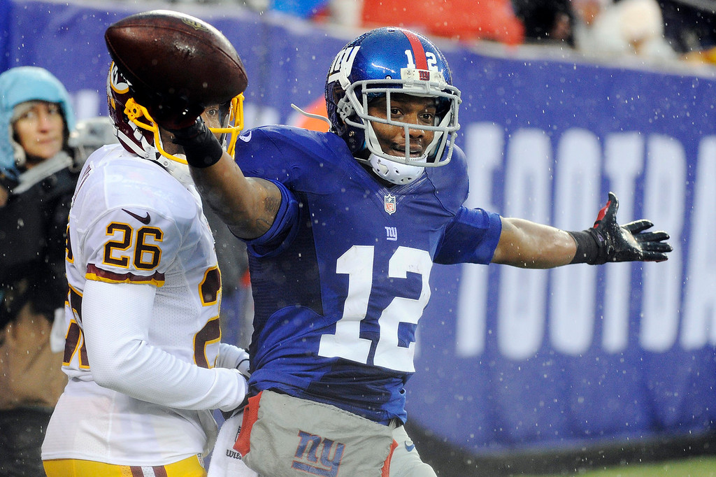 . New York Giants wide receiver Jerrel Jernigan (12) celebrates a touchdown reception during the first half of an NFL football game against the Washington Redskins, Sunday, Dec. 29, 2013, in East Rutherford, N.J.  (AP Photo/Bill Kostroun)