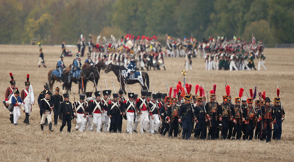 . Historical society enthusiasts in the role of troops fighting under Napoleon move into position while re-enacting The Battle of Nations on its 200th anniversary on October 20, 2013 near Leipzig, Germany. (Photo by Sean Gallup/Getty Images)