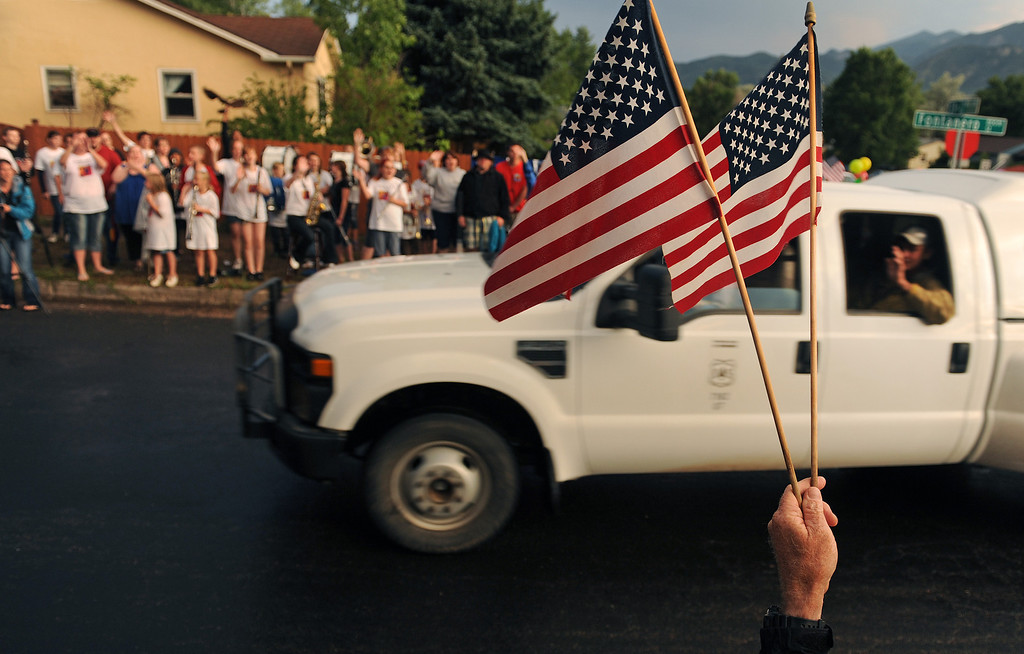 . Residents of the Colorado Springs community turn out each night at the intersections of Fontanero and 31st streets in downtown Colorado Springs to show their appreciation for the firefighters coming off the fire line on July 3rd, 2012. Helen H. Richardson, The Denver Post