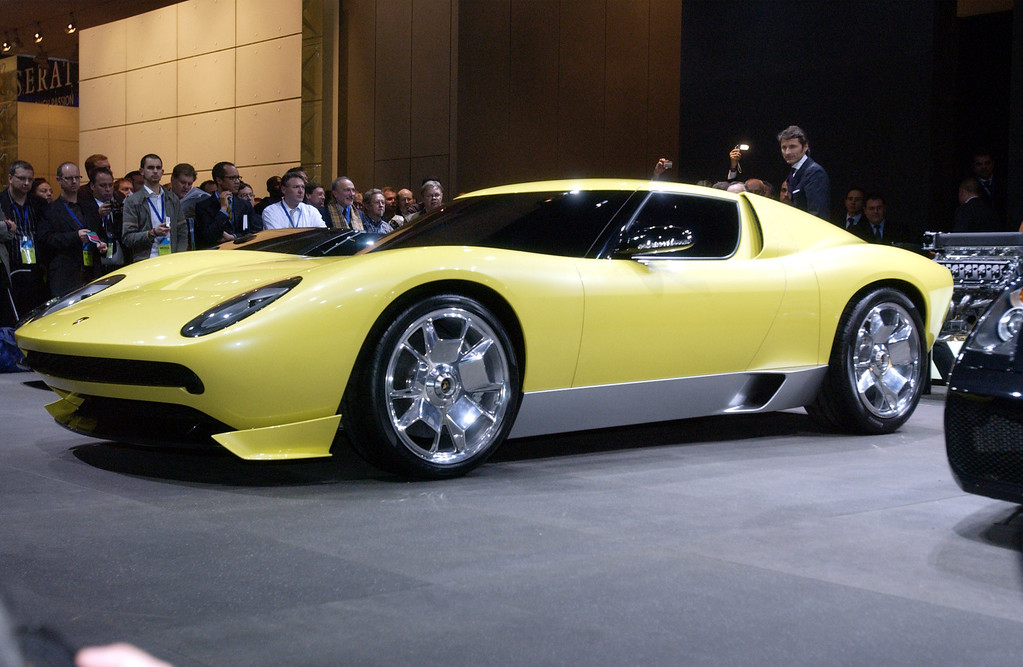. The Lamborghini Miura concept vehicle is unveiled at the North American International Auto Show in Detroit, Sunday, Jan. 8, 2006.  (AP Photo/Jerry Mendoza)
