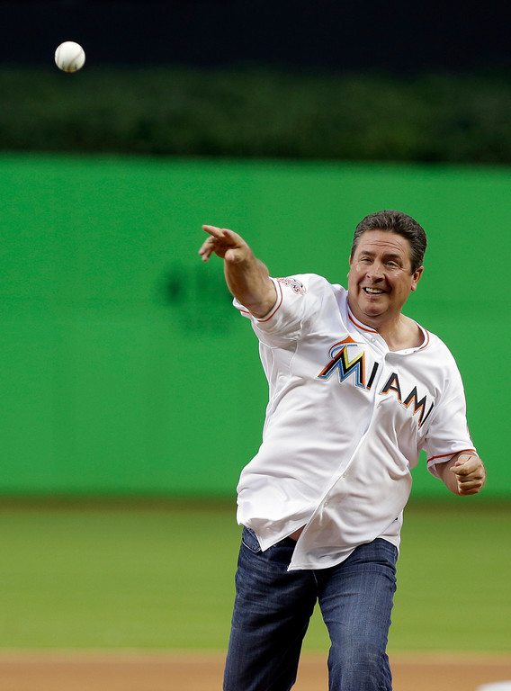 . Former Miami Dolphins quarterback Dan Marino throws out the ceremonial first pitch before an opening day baseball game between the Miami Marlins and Colorado Rockies, Monday, March 31, 2014, in Miami. (AP Photo/Lynne Sladky)