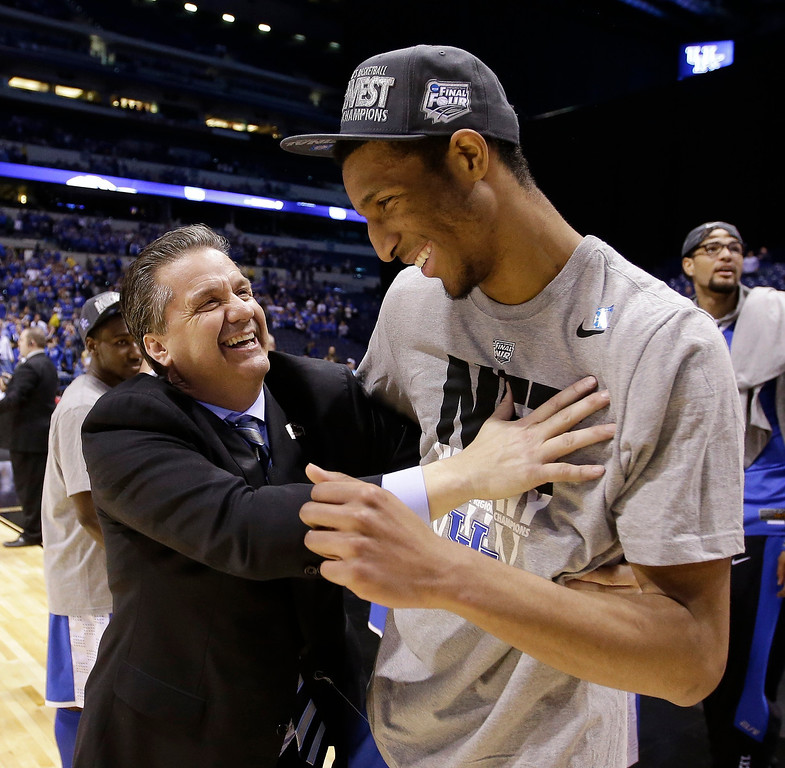 . Kentucky head coach John Calipari, left, celebrates with Marcus Lee after an NCAA Midwest Regional final college basketball tournament game Sunday, March 30, 2014, in Indianapolis. Kentucky won 75-72 to advance to the Final Four. (AP Photo/David J. Phillip)