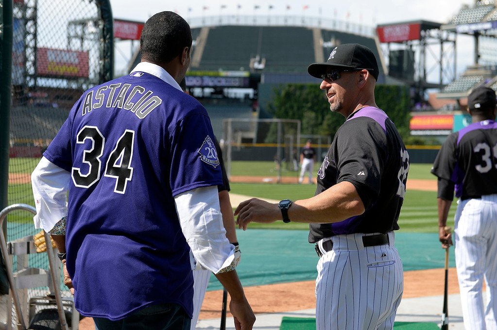 . Colorado Rockies Walt Weis is greeted by Pedro Astacio during an open workout session July 18, 2013 at Coors Field. (Photo By John Leyba/The Denver Post)