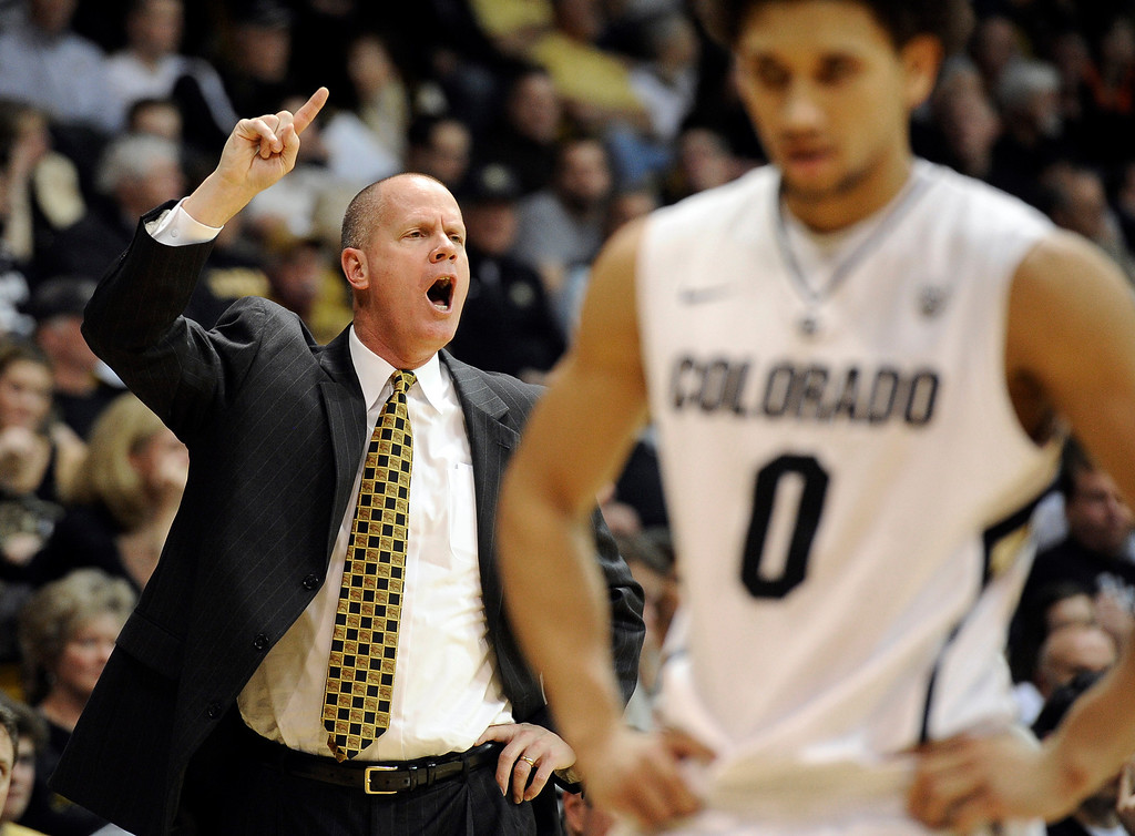 . University of Colorado head coach Tad Boyle yells to his players, including Askia Booker, at right, during a game against the University of Southern California on Thursday, Jan. 10, at the Coors Event Center on the CU campus in Boulder.   Jeremy Papasso/Daily Camera