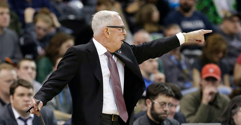 . San Diego State coach Steve Fisher motions to his players in the first half against New Mexico State during a second-round game of the NCAA men\'s college basketball tournament in Spokane, Wash., Thursday, March 20, 2014. (AP Photo/Elaine Thompson)