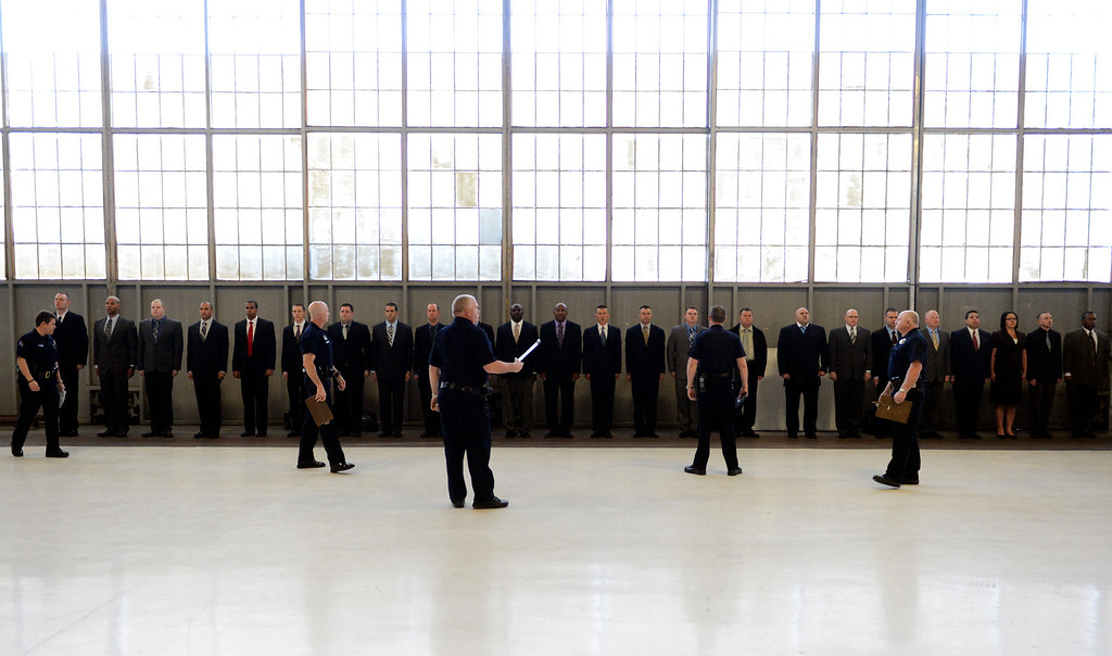 . Recruits stand at attention during roll call on the first day of police academy training for the Denver Police Department, April 29, 2013. (Photo By RJ Sangosti/The Denver Post)