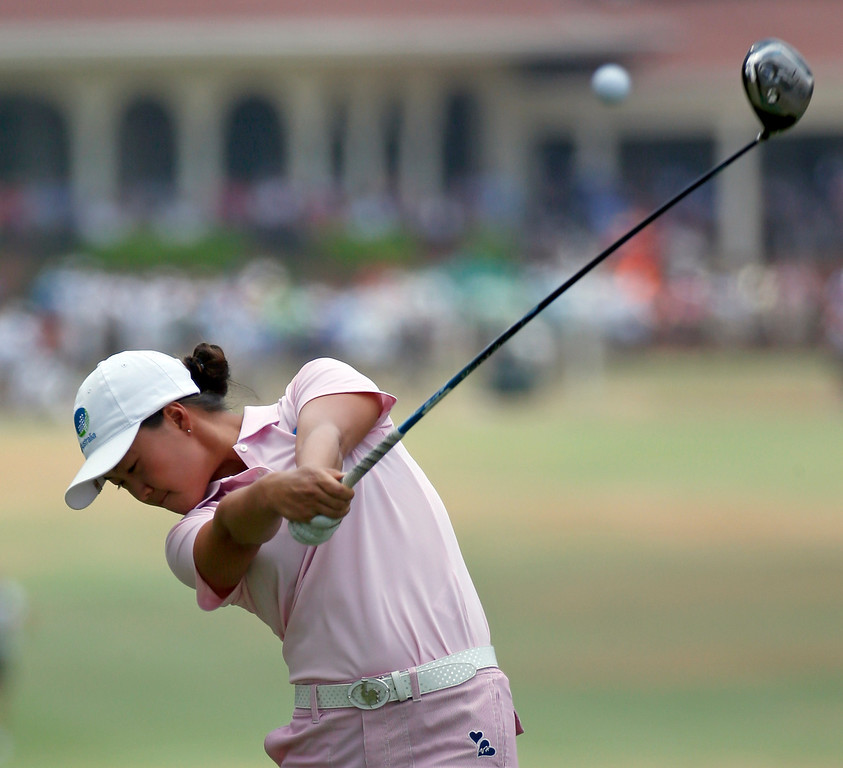 . Minjee Lee, of Australia, hits her tee shot on the second hole during the final round of the U.S. Women\'s Open golf tournament in Pinehurst, N.C., Sunday, June 22, 2014. (AP Photo/John Bazemore)
