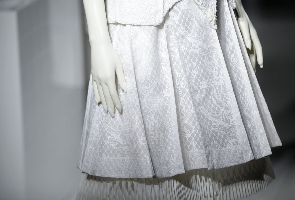 . A model wears white rubber gloves with nails as she models the Thom Browne Spring 2014 collection during Fashion Week in New York, Monday, Sept. 9, 2013.  (AP Photo/Seth Wenig)