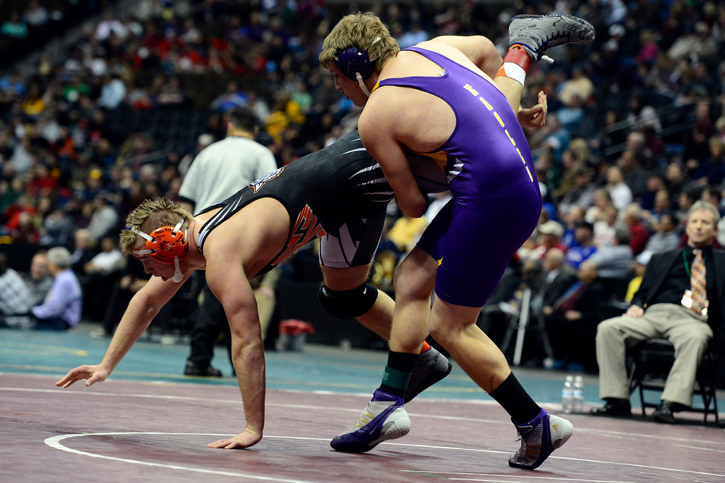 . DENVER, CO - FEBRUARY 23: Justin Lennox defeats Treuett Box in the class 2A 220-pound final during the Colorado State High School Wrestling Championships. The state\'s top wrestlers squared off in four classes in front of a near-capacity crowd at the Pepsi Center. (Photo by AAron Ontiveroz/The Denver Post)